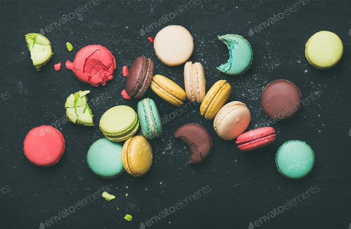 Flat-lay of sweet colorful French macaroon cookies variety