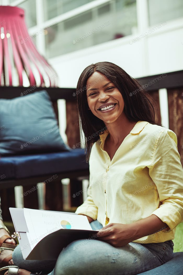 African American businesswoman smiling during a casual office meeting