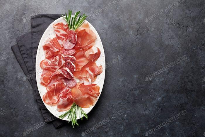 Spanish jamon, prosciutto crudo ham, italian salami