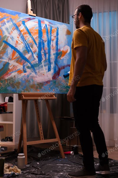 Abstract painter holding roller