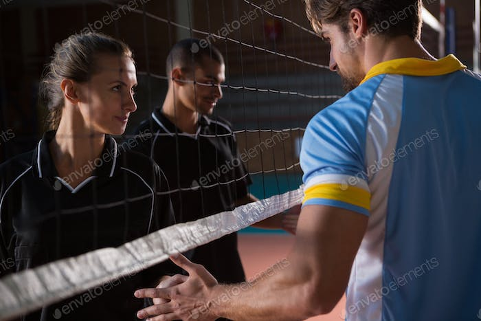 Volleyball players giving handshake