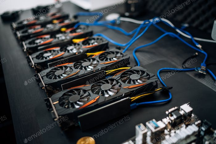Gpu cards preparing to mine cryptocurrency, devices on mining rig. bitcoin.