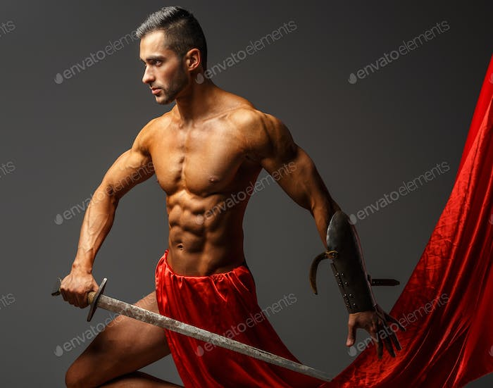 Shirtless guy holding sword