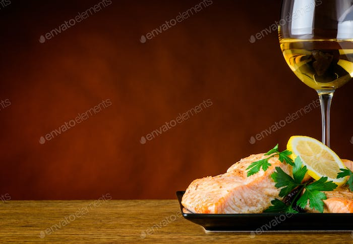 Closeup of Cooked Fish Fillet and White Wine with Copy Space