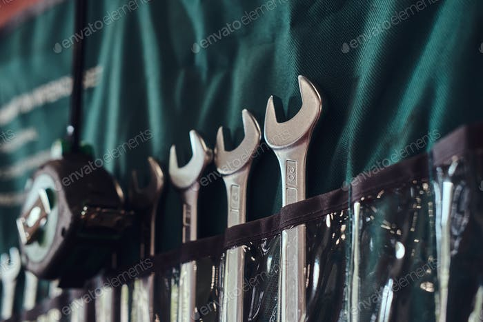 Different sizes of wrenches on the wall