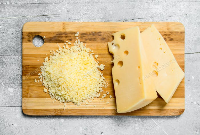 Fresh grated cheese on a wooden Board.