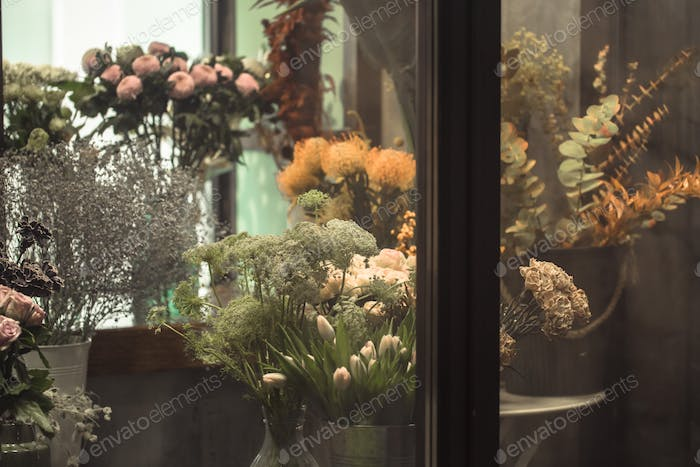 Beautiful showcase with a variety of fresh flowers flower shop.