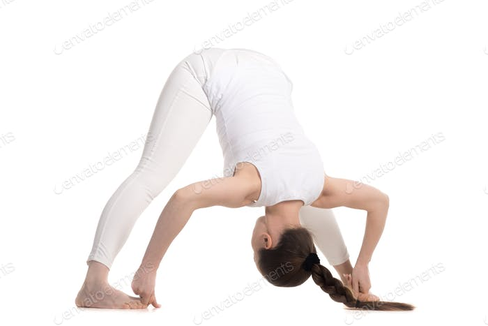 Yogi female standing in Wide Stance Forward Bend