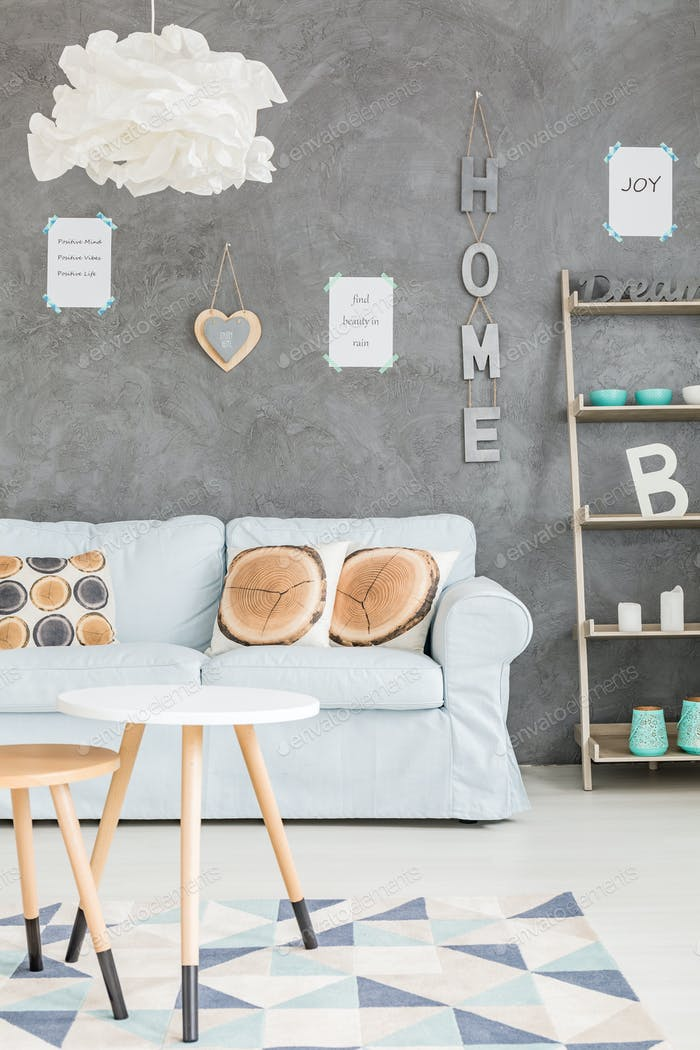 Room with grey wall and letters