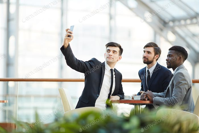 Posing for selfie with business partners