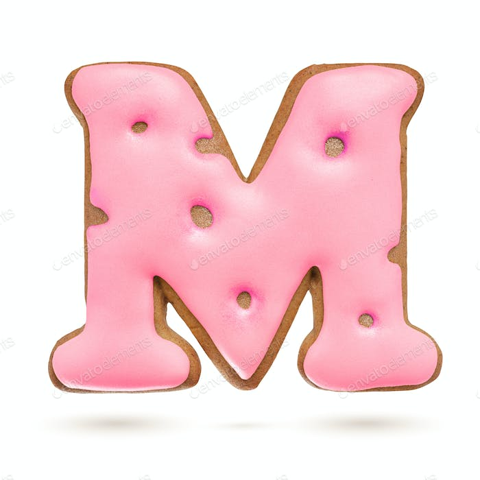 Capital letter M. Pink gingerbread biscuit isolated on white.