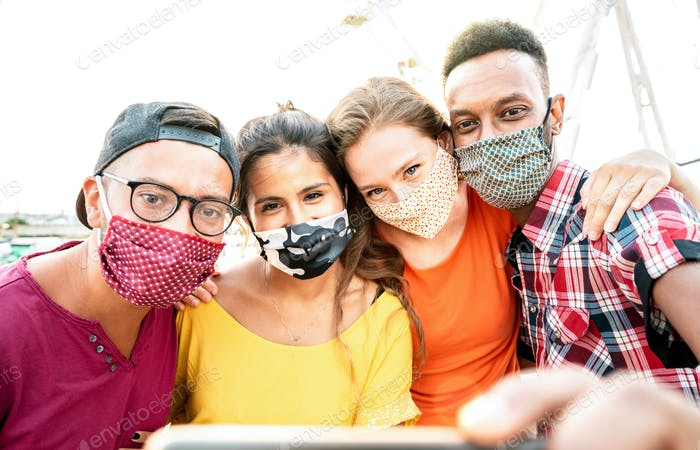 Multicultural milenial travelers taking selfie with closed face masks