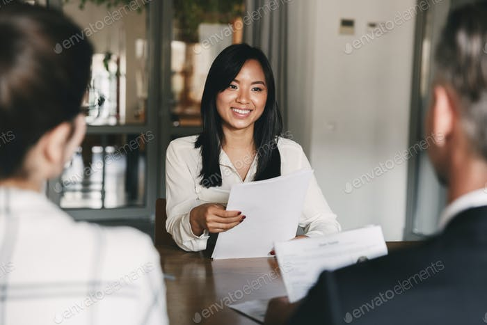 Business, career and recruitment concept - young asian woman smi