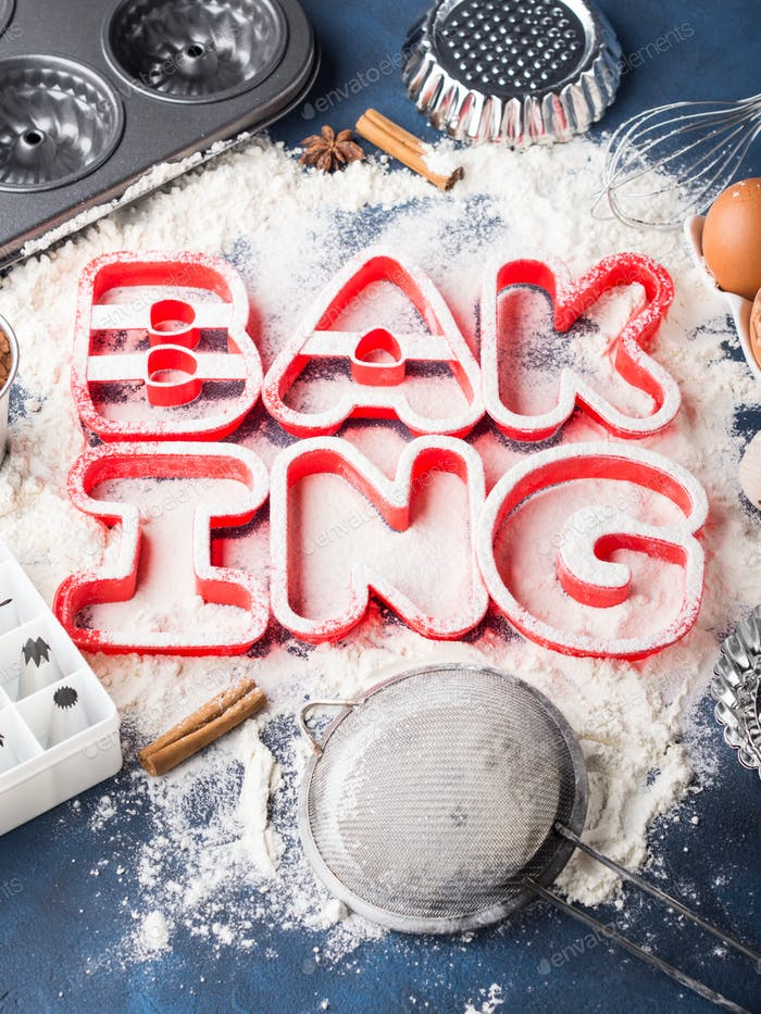 Flour letters spelling Baking with tools and ingredients