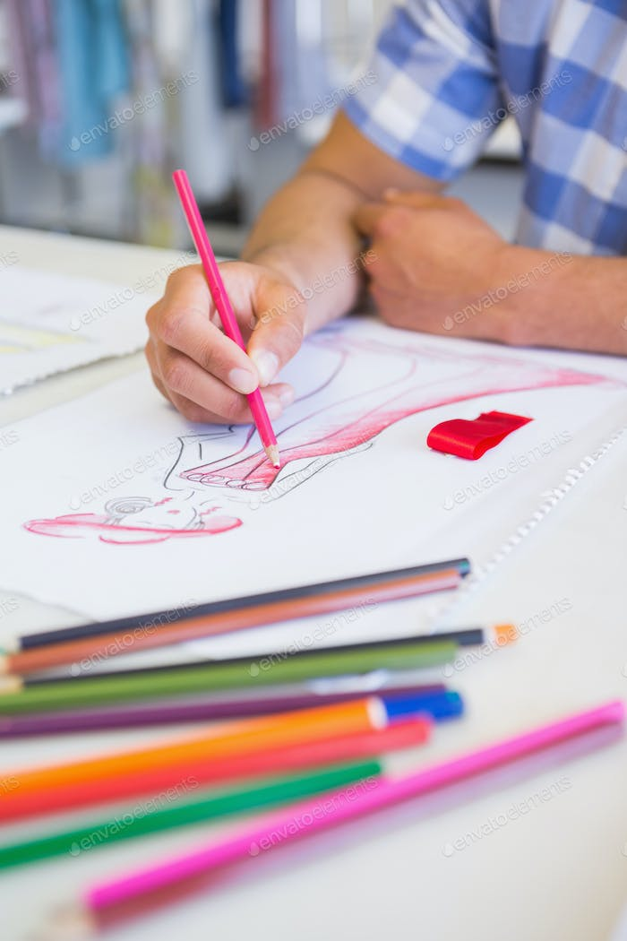 College student drawing picture with colored pencil at the college