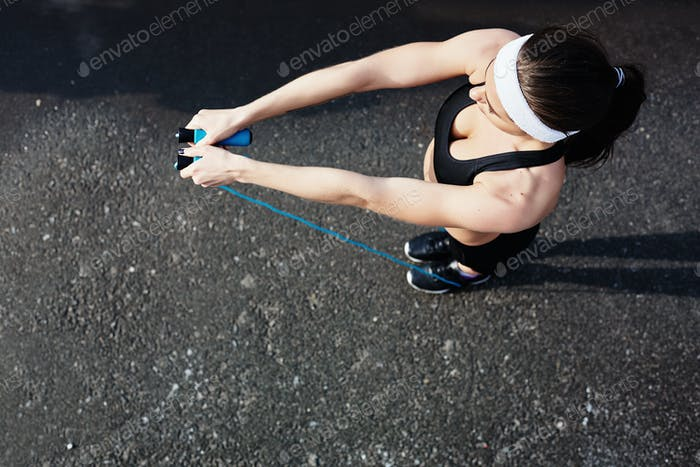 Sportswoman with skipping-rope