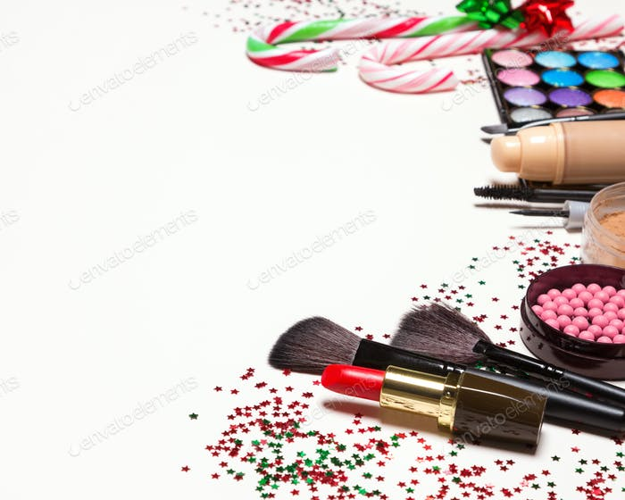 Christmas makeup cosmetics and accessories with copy space