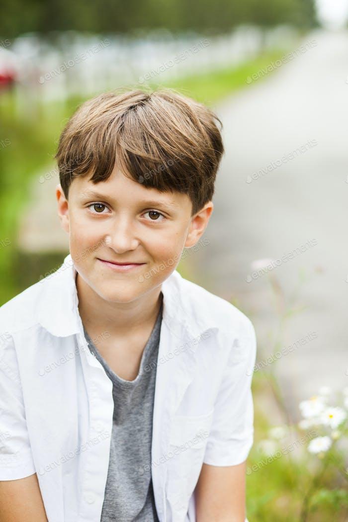 Portrait of happy pre-adolescent boy