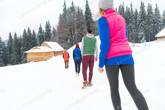People Group Near Wooden Country House Winter Snow Resort Cottage