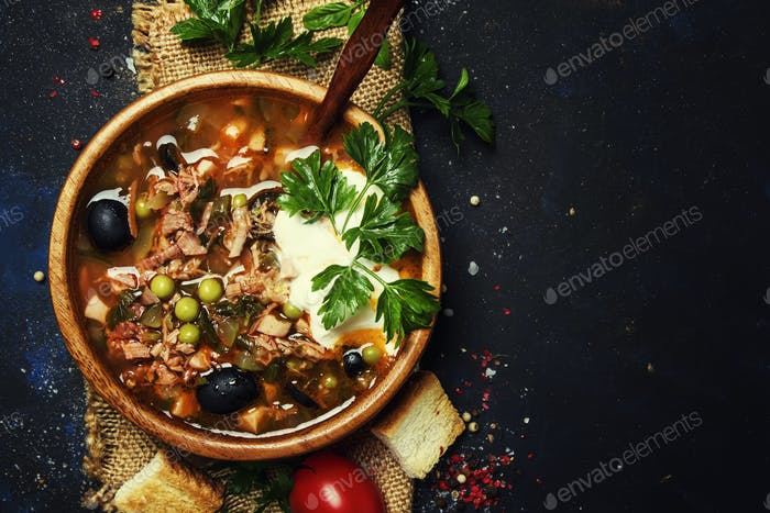 Russian Meat Solyanka Soup In Wooden Bowl