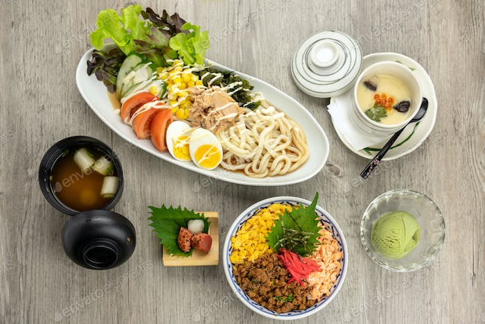 Top view of japanese foods set, fried rice with udon ramen with egg and tuna salad,