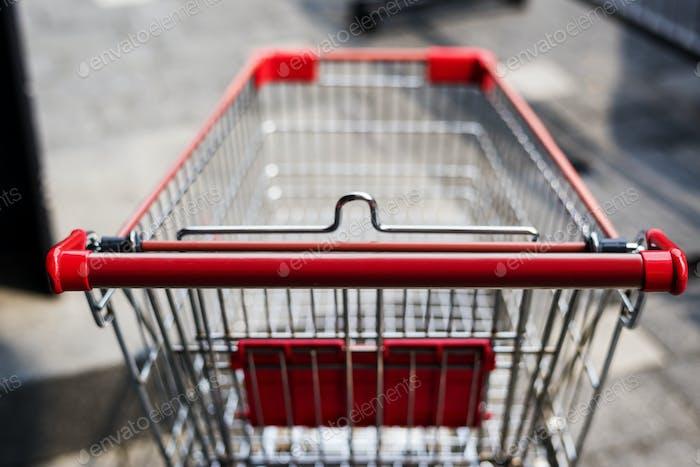Empty shopping trolley left outside