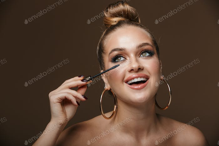 Close up beauty portrait of an attractive young topless woman