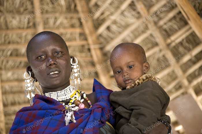 portrait of a masai mother and his son