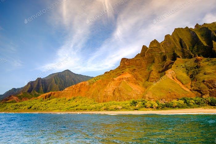 Landscape view of Na Pali coastline cliffs and beach, Kauai, Hawaii