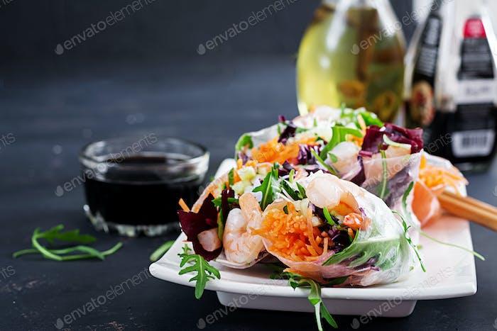 Vegetarian vietnamese spring rolls with spicy shrimps, prawns,  carrot, cucumber