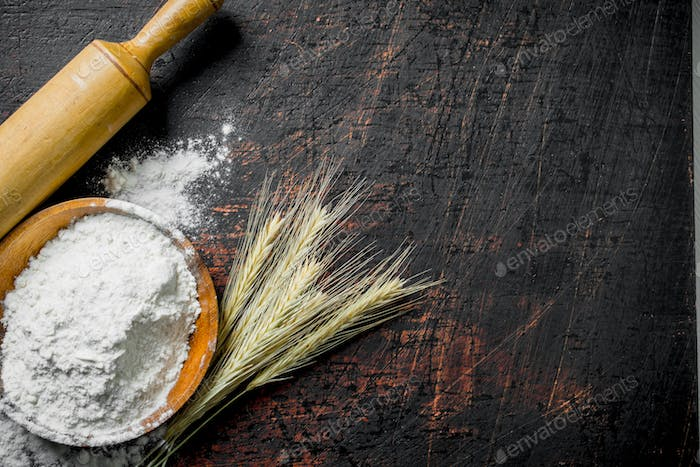 Flour with spikes and a rolling pin.