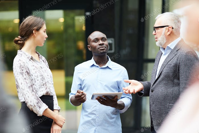 Group of Modern Business People Discussing Work Outdoors