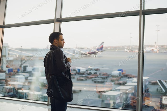 Silhouette of man waiting for the flight
