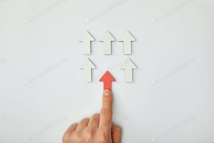 cropped view of man putting red arrow to row with white pointers on grey background