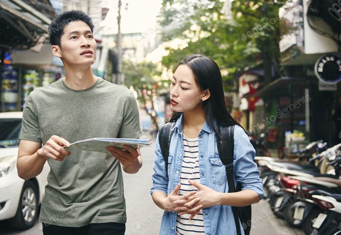 Tourists with paper map in the city