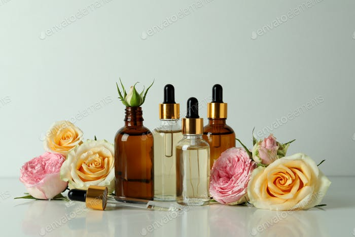 Skin care concept with essential rose oil on white background