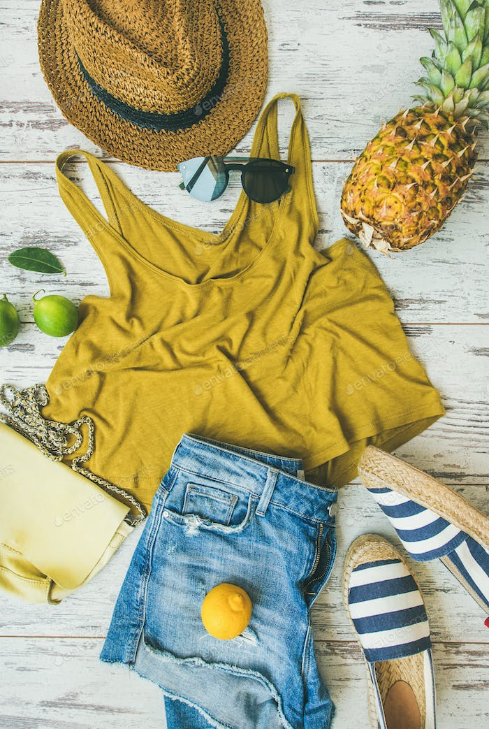 Colorful summer fashion outfit flat-lay over pastel parquet background