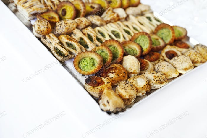 Tray of appetizers and small tarts for a cocktail