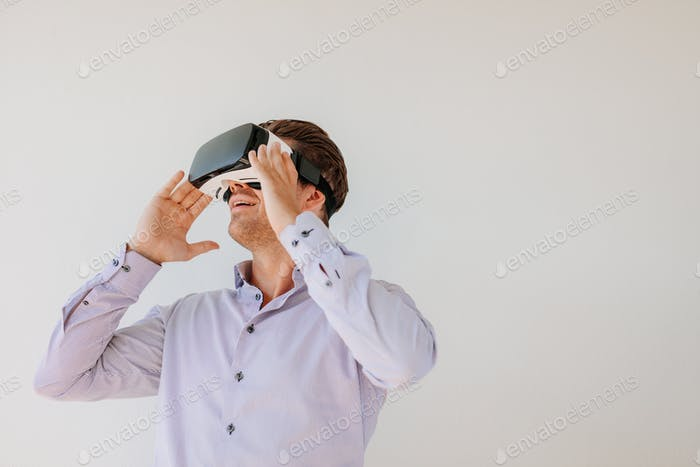 Caucasian male model wearing VR goggles