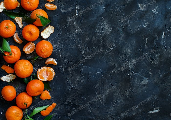 Mandarins with leaves  on a black background