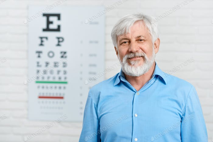 Old patient staying in front of visual inspection table