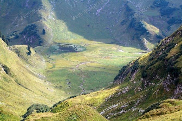 wild alpine lake between mountains
