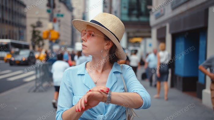 Young confused woman in the city