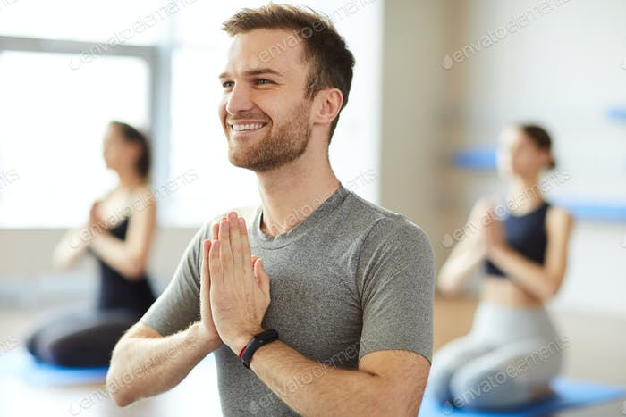 Happy man enjoying meditation
