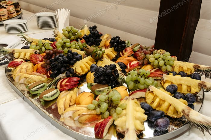 rich many fresh fruits on luxury wedding table at the reception, catering in restaurant