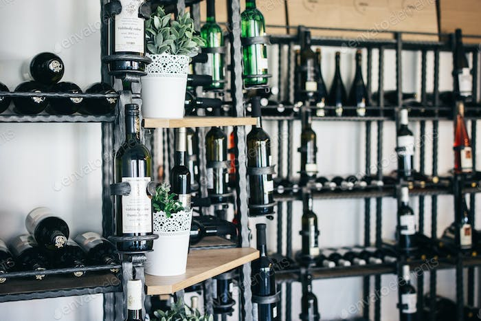 Wide selection of bottles of wine in wineshop