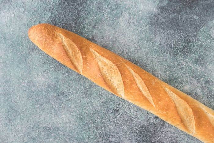Baguette on the wooden background