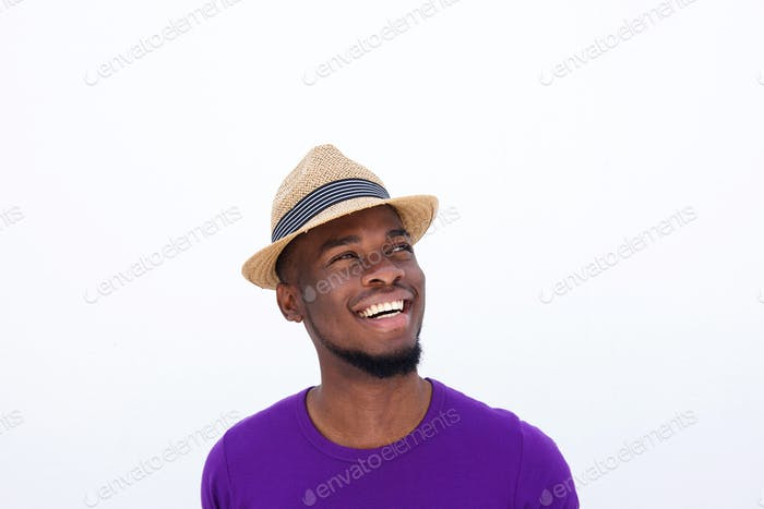 Young man with hat looking away and smiling