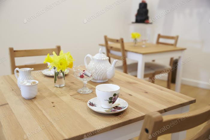 Interior Of Empty Tea Shop With Tables And Crockery