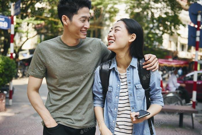 Happy Vietnamese couple in the city